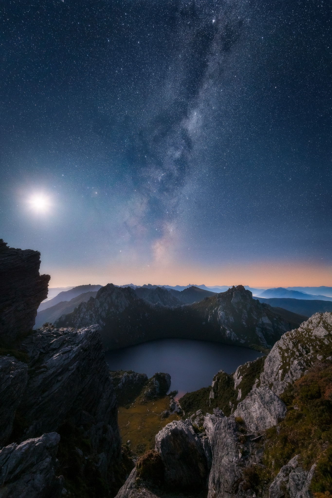 Genesis : Moonrise, Milkway rise and the beginnings of sunrise as shot from the saddle above Lake Oberon.