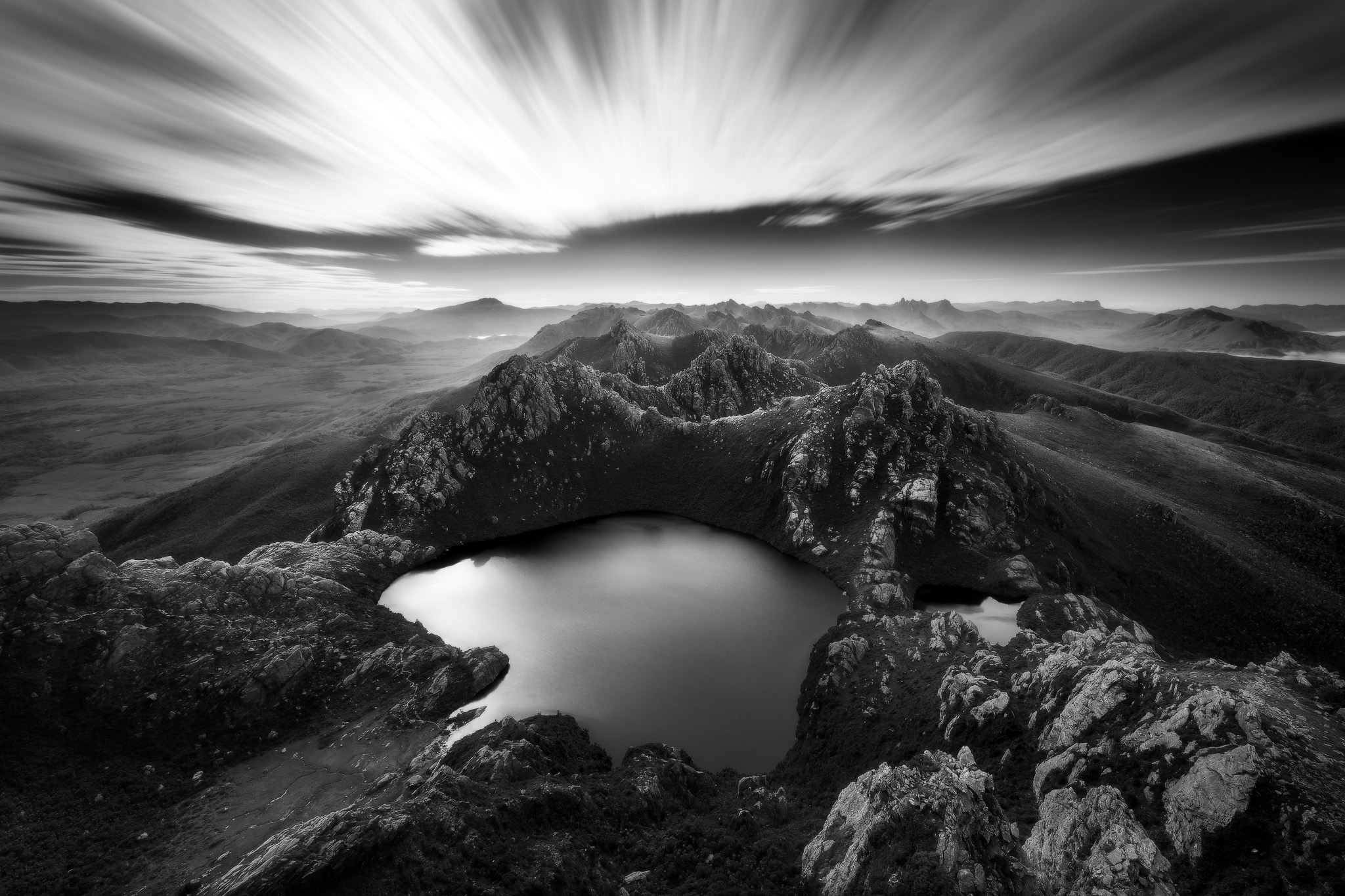 Hypnosis : Cloud rush past overhead as we looked down upon Lake Oberon from the summit of Mount Sirius. 15 stop ND filter used for the sky effect.