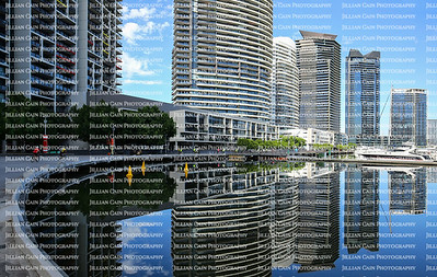 Skyscrapers reflect into the Yarra River in downtown Melbourne, Australia.