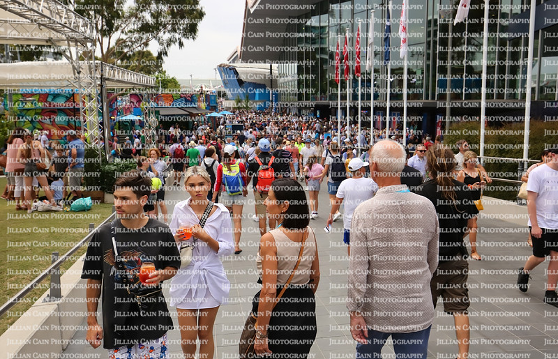 Large crowds of tennis enthusiast walk outside at the Australian Open. The AO is the first Grand Slam tennis tournament of the year.