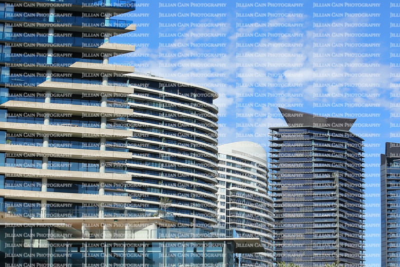 Close up of skyscrapers along the Yarra River in downtown Melbourne, Australia.