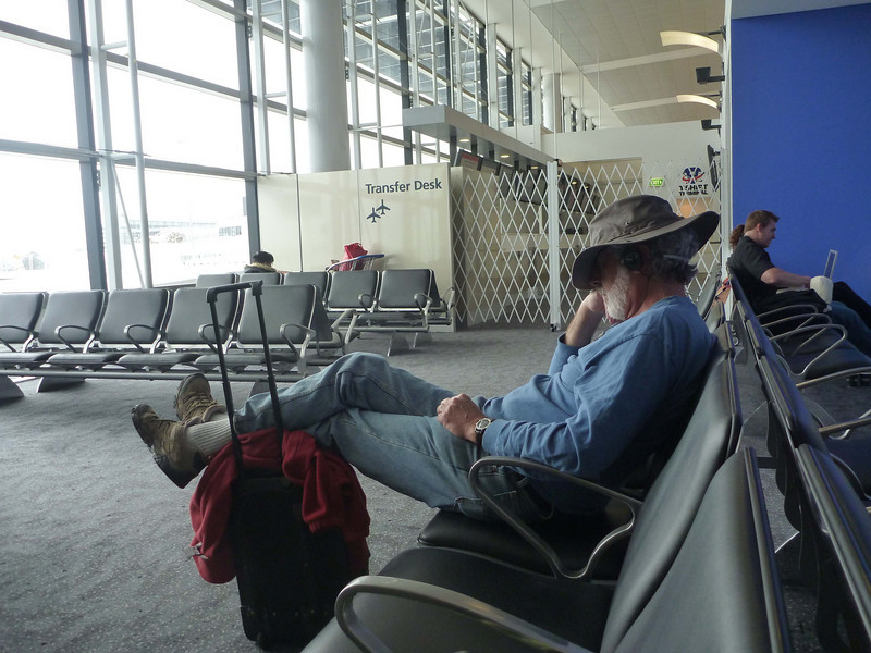 "We had to leave our hotel at 10 AM for a 3:30 PM flight (various reasons) so we did a lot of waiting for our flight to Los Angeles and then home.  I kind of like the ""tired cowboy"" look of Peter, here.  He doesn't like his hat, but I do."