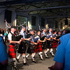 Bagpipe band marching back and forth playing. This is one of my first experiments with motion blur and I'm happy with the result. The drummers in the foreground and the audience in the back appear a bit out of focus, but that is entirely from me moving the camera and nothing to do with depth of field. All static shots had the fore and background in razor sharp detail. The only thing here in complete focus is the band itself.