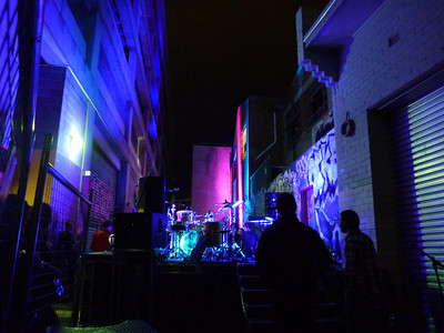 The view from backstage at the Faux Mo afterparty for The Dresden Dolls' 4th performance in 3 days. The stage was in the alley behind the Grand Poobah club, lit up with all colors, set off by graffiti.
