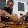 The chef stirring at the Really Big Paella cooking demo. It was aptly named.<br /> I like that only the paella is in focus and it isn't a perspective trick that makes this dish look huge.