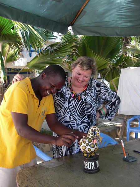 James feeding the tip giraffe, with Christiane watching.<br /> Watamu, Kenya