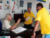 Lorenzo giving instructions to his Blue Fin Diving staff, Sergio and Enrico.<br /> Watamu, Kenya