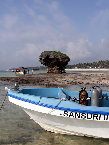 Our dive boat, Sansuri (Barracuda), anchored in the bay at low tide.<br /> Watamu, Kenya