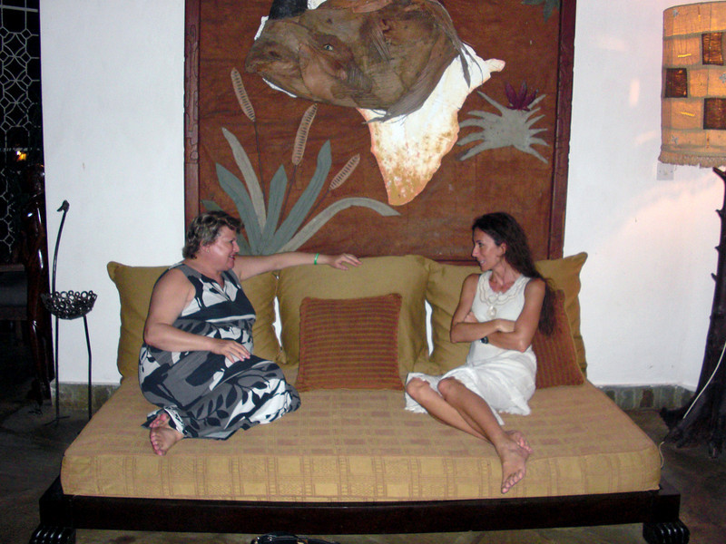Christiane and Camella, share a chat.  Camella and Angelo, her husband, hosted a dinner at their Malindi home.  The walls were adorned with unique art, created out of natural materials.<br /> Malindi, Kenya.