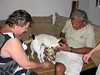 Christiane and Lorenzo receiving attention from Camella and Angelo's curious and friendly doggies.<br /> Malindi, Kenya.