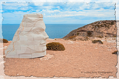 'Mara Healing' a sculpture by local artist, Siv Grava on a cliff overlooking Waterloo Bay at Elliston, South Australia.  According to the artist, Mara is a mythical goddess who has come to the cliffs to help heal sorrows of the past.  In early settlement a number of aboriginals were sent to their deaths over cliffs near this spot. For me personally, I don't feel the artist has captured Mara's sense of healing, she doesn't appear 'motherly' to me, in fact she seems aloof.  Photographed February 2012 - © 2012 Lesley Bray Photography - All Rights Reserved.