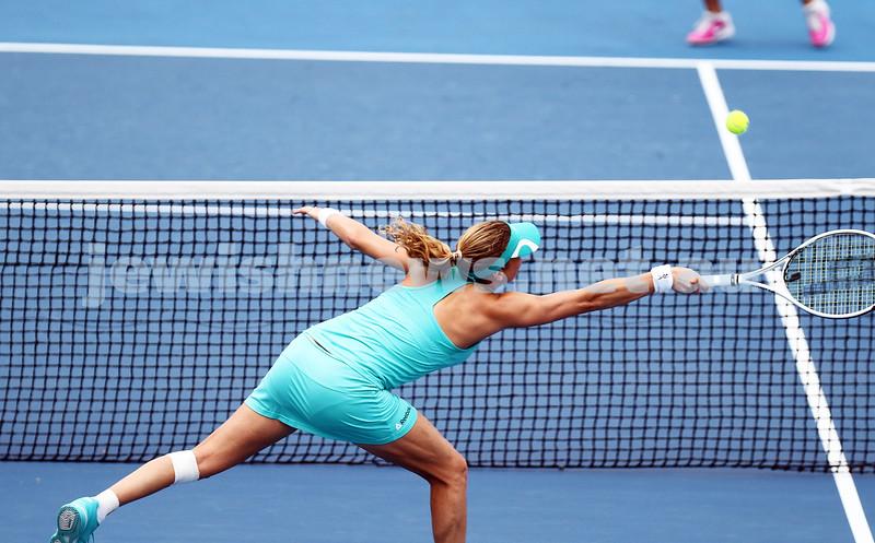 19-1-14. Australian Open 2014. Womens doubles. Round 3. Shahar Peer (ISR) / Silvia Soler-Espinosa (ESP) def. Lucie Hradecka (CZE) /  Michaella Krajicek (NED) 4-6 7-6 6-2. Photos: Peter Haskin