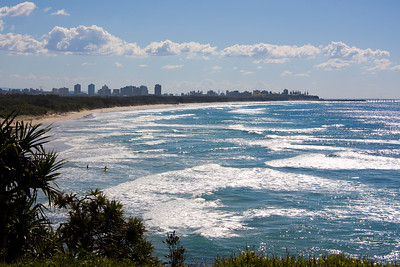 Looking north from Fingal Head over Fingal Head Beach which evolves into Letitia Beach further north - the next headland is Point Danger and the tall buildings are on the beachfront at Coolangatta. Difficult to photograph because of position of sun.
