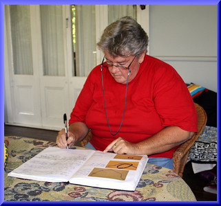 Beverley Fairley recording the day's events in her journal.  Photographed April 2007 - © 2007 Lesley Bray Photography - All Rights Reserved.