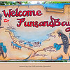 Sign welcoming us to Punsand Bay sign, Cape York Peninsular, Queensland, Australia.  Unfortunately the sign was the only bright thing about Punsand  Bay,  it was a disappointment to me as the facilites have been allowed to run into disrepair which was in contrast to my previous visit a few years ago when I thoroughly enjoyed myself.<br /> <br /> Photographed June 2010 - © Lesley Bray Photography