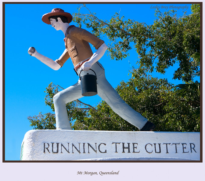 Interesting monument at Mt Morgan, Queensland, Australia.  'Running The Cutter', was an old custom practised by Mount Morgan miners buying beer in billy-cans and drinking outside a hotel. The Billy-can (tin billy) was known as the 'cutter'.  Another version of 'running the cutter' was when a miner finished his work at the end of the shift he would have a young lad run over to a hotel with his tea-billy, have it filled with beer and brought back to him as he came off shift.   <br><br> Photographed August 2010 - © 2010 Lesley Bray Photography - All Rights Reserved. <br><br> Do not remove my signature from this image. Sharing only with credit please.