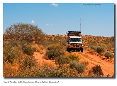 We move off the QAA Line into the soft sand to allow a fellow traveller pass in safety.  Fortunately, between the use of the 2 way and his sand flag we knew he was travelling towards us. Simpson Desert National Park, Outback Queensland.  Photographed September 2010