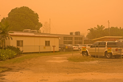 I haven't taken a photo for a while, unfortunately - yesterday I ran out of my office to take this one.  It would have been nicer if I had the time to drive to another location and photograph a view of our city in a dust storm - that was not to be - so you are left with a view of my office which is the old demountable building you can see.  This was taken at 1pm with the sun glowing through the dust.  Brisbane Airport was closed due to poor visibility.  New South Wales experienced a far worse dust storm than this.