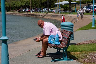 Sunday 9 March 2008 - Found this guy sitting by the waterfront at Manly, a mobile phone in one hand and instruction leaflet in the other.  I can emphasize with his dilemma.  He was so engrossed he didn't realise I captured his photo.