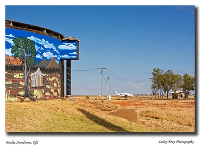 View of the aerodrome at Boulia, Western Queensland.  The colourful mural on the town water reservoir is seen on the left.
