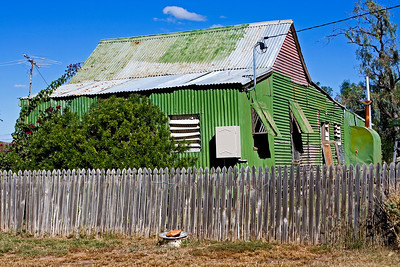 I'm always intrigued by the tin houses found in western Queensland.  I imagine they are hot in summer and cold during winter.  We found this one in Winton.  23 May 2010