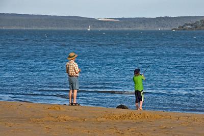 Boy fishing at Coochiemudlo Island, Queensland, Australia