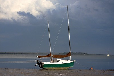 Grounded at low tide - storm clouds getting serious now.