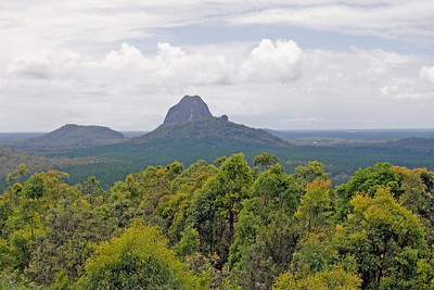 Cooee on the rear at the left - Mt Tibrogargan is the high mountain to the right of Cooee with Mt Tibberoowuccum in the foreground.  Taken from Glasshouse Mountains Lookout - February 2010