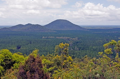 Mt Beerburrum in the centre - flanked on the left by the Trachyte Range  Mt Beerburrum was once an active volcano, but its glory are over...it hasn't erupted for thousands of years.  Taken from Glasshouse Mountains Lookout - February 2010
