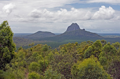 Mountain on the right is Mt Tibrogargan - the hill on the rear left is Cooee and Mt Tibberoowuccum in the foreground (looks like a hill compared to Mt Tibrogargan.  Taken from Glasshouse Mountains Lookout - February 2010