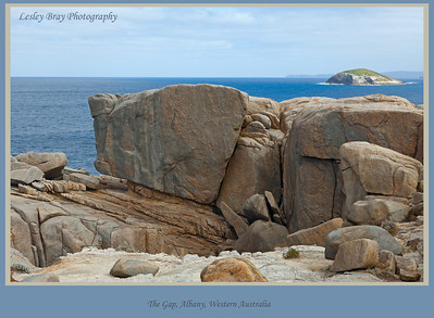 Huge rocks on Natural Bridge near The Gap, Torndirrup National Park, Albany, Western Australia.  One of the Green Islands in the background in the Great Southern Ocean.  Photographed September 2011 - © Lesley Bray - All Rights Reserved.