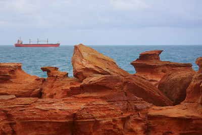 Freighter sails past the point.
