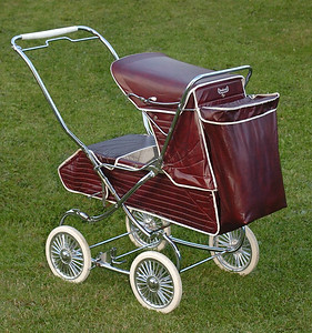 A slightly later example of the same pram, this one is the 1977-78 version. Still in the 'Claret' colour option, however, there were changes to the plastics and fillings used in manufacture around 1976 as this version is more of a solid colour compared to the marbled and mottled effect of 1968-75 'Claret' colours across the model range. The rear accessory shopping bag is actually from the earlier 1975 model as the later versions of these carriers were shorter in length and did not go right down the back of the pram body.