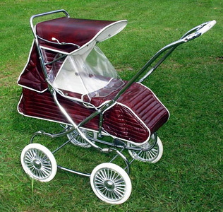 A 1975 Steelcraft Regal in Claret. This one is fully restored and very original. These prams were very protective, fully waterproof  and suitable for babies from birth and up. The front footcover made the pram more like a bassinet for a new baby, whilst the clear plastic wrap around visor clipped onto the footcover and up to the side curtains. With the hood locked forward  the pram was very enclosed and weather proof.