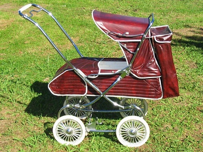 "This is a 1975 ""Regal"" (P677) and this colour is called ""Claret"". The Steelcraft Regal model was a very popular and quite common pram used in Australia from the mid 60's right up until the end of local production around 1985. Just like cars, there were many small changes made to this particular model through its entire production run.  Some of the changes in upholstery trim, vinyls and frame fittings were barely noticeable, whilst other changes (and sometimes improvements to the overall design) made distinctive visual differences to the size and style of this model. The overall shape and look of the pram stayed the same throughout its (approximate) twenty year production run."