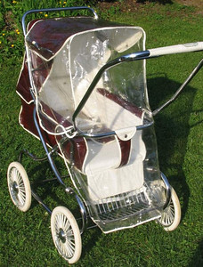 "1970's Steelcraft  ""W19"" optional stormcover.. These raincovers replaced the front footcover / windshield combination that was used for a younger baby. With the footrest lowered and the rear half of the seat raised the pram could now be used like a large stroller for a child up to 3+ years old. Very hard to find surviving examples of these kind of accessories as many were lost over the years with many more being ripped and destroyed, usually by older kids in the prams trying to kick/ pull them off ."
