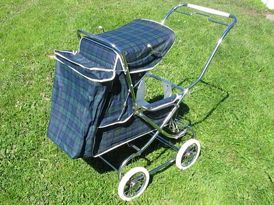 "Restored 1969 Steelcraft Regal pram in the colour ""Black Watch Tartan"" vinyl  This is a re-badged version of the Steelcraft Regal pram sold exclusively  through the 'London Baby Carriages' chain of stores."