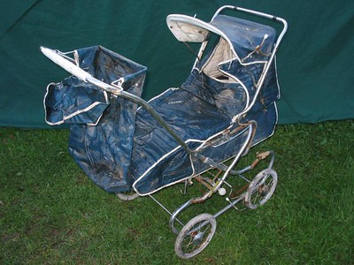 This seriously neglected Cyclops pram comes complete with all it's original accessories.