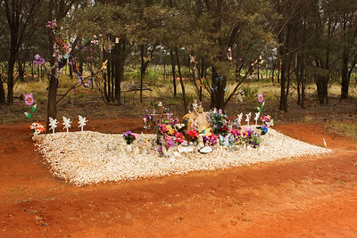 We came across this roadside memorial to a young woman amongst the Mulga trees near the Ward River west of Charleville, western Queensland.  This is the largest memorial I have seen honouring one person beside a road.  RIP Toni  Photographed August 2010 - © 2010 Lesley Bray Photography - All Rights Reserved.