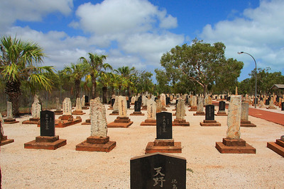 The Japanese Cemetery at Broome (which is the largest Japanese cemetery in Australia) dates back to the very early pearling days and bears witness to the close ties Japan established with Broome in the early twentieth century. The first recorded interment in this cemetery is 1896. Literally hundreds of young Japanese divers died either from the bends (divers paralysis) or from drowning. A large stone obelisk in the cemetery recalls those who were drowned at sea in the 1908 cyclone. The cyclones of 1887 and 1935 each caused the deaths of at least 140 men.  To give some idea of the scale of deaths resulting from the bends it is worth noting that the cemetery has the graves of 33 men who died of divers paralysis in 1914. There are 707 graves (919 people) with most of them having unusual headstones of coloured beach rocks.