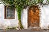 A street with decorative vines and doorway in Hallstatt, Austria, Europe.