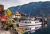 A water taxi boat docked in Hallstatt, Austria, Europe.