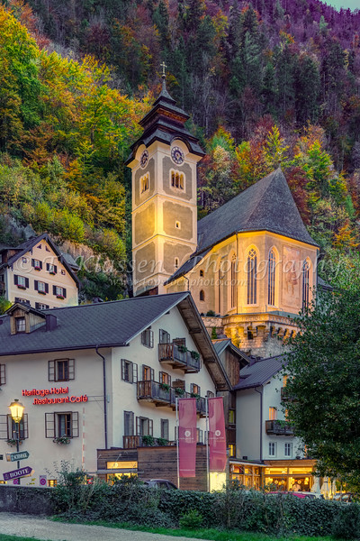 The Catholic parish church with fall foliage color in Hallstatt, Austria, Europe.