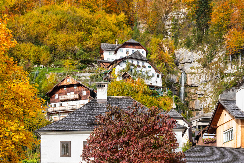 Hillside village buildings with fall foliage color in Hallstatt, Austria, Europe.