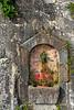 A decorative planter and stone wall in Hallstatt, Austria, Europe.
