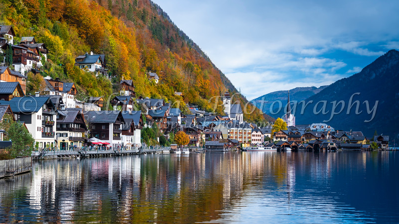 A view of the village, Hallstattersee and fall foliage color in Hallstatt, Austria, Europe.