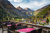 An outdoor restaurant overlooking the valley in Heiligenblut, Tyrol, Carinthia, Austria, Europe.