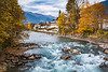 The Drava River with fall foliage color in Lienz, East Tyrol, Austria, Europe.