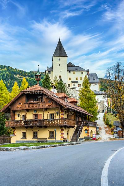 A village with the Burgmauterndorf Castle, Austria, Europe.