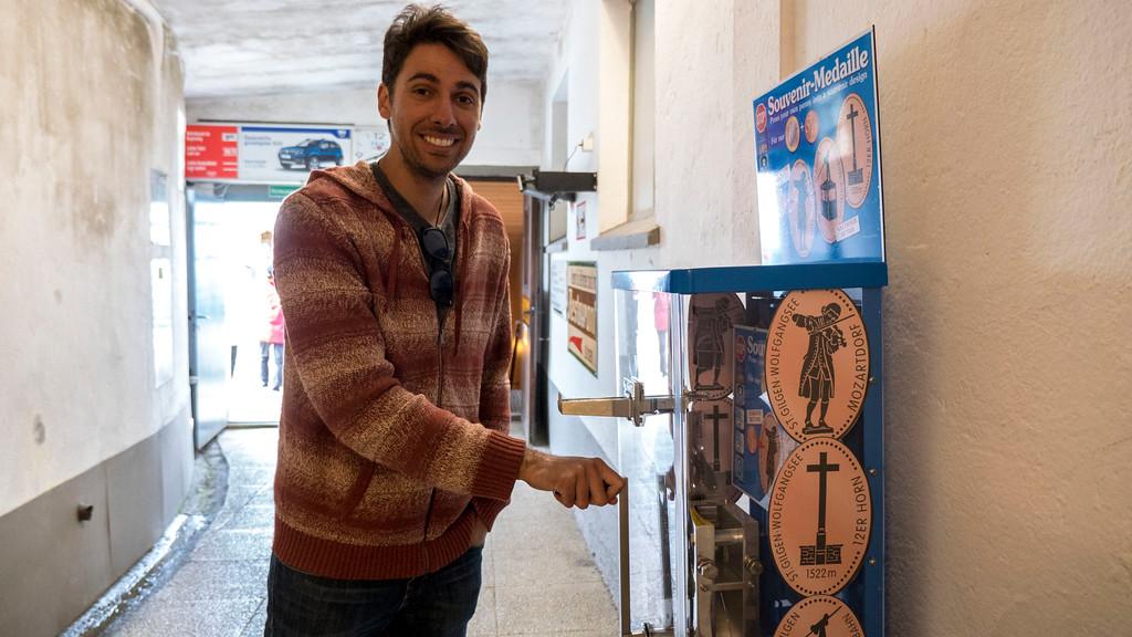 Pressing a penny in St Gilgen Austria